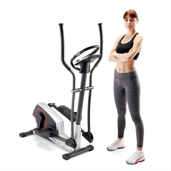 Model standing next to the Regenerating Magnetic Elliptical Trainer Machine Marcy ME-704