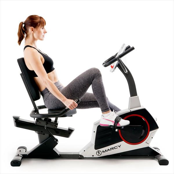 Model using seat handles on the Regenerating Magnetic Recumbent Bike | Marcy ME-706