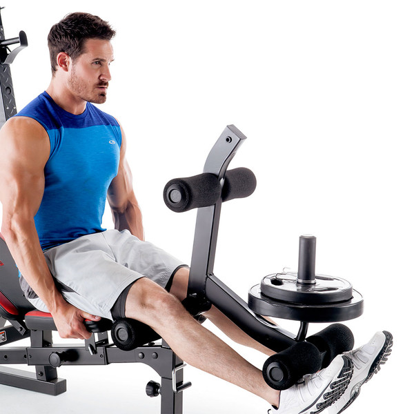 The Marcy Deluxe Olympic Weight Bench MKB-957 Leg Developer used with Olympic plates to do leg extensions