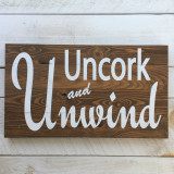 "Pine Floor Board Sign - ""Uncork and Unwind"""