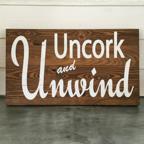 """Pine Floor Board Sign - """"Uncork and Unwind"""""""