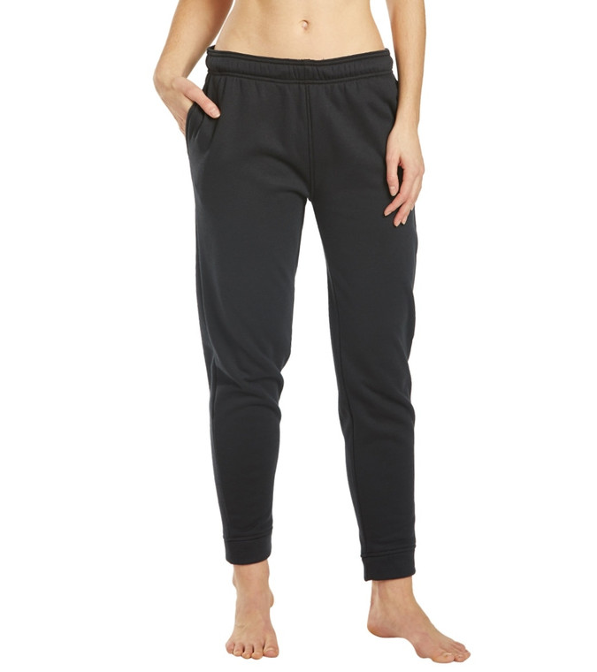Comfortability is key in the Speedo Women's Team Pant.  Features Women's team pant. Solid. Soft touch fabric. Thermal brushed on the inside. Logo accent at thigh and waistband. Pockets. Ankle length. Drawstring closure. Details Fabric: 76% Polyester, 24% Cotton. Care: Machine washable. Closure: Drawstring. Fit: Standard. Adjustable: Drawstring. Length: Ankle length.