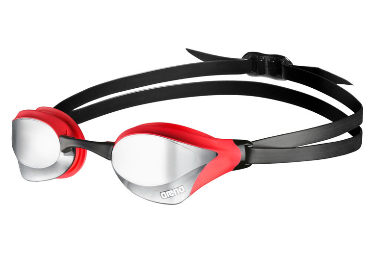 The high-quality arena unisex goggles Cobra Core Mirror are perfect for competition.  They are designed for athletes and swimmers which are looking for top of the line racing goggles with hydrodynamic design.  The small frame and the sleek seal provide a stable fit in the eye socket and minimize the drag.  The innovative design of the lenses reduces the water turbulences and allows you to swim faster.  The curved and mirrored lens shape dramatically increases peripheral and frontal vision.  For an expanded field of view and a better side view to the competitors.  Delivered with four interchangeable nose bridges for a perfect customization to the different face and nose shapes.  The dual strap is easily adjustable at the back of the head and guarantees a stable fit, even during start and turn.  The goggles are equipped with an anti-fog coating, UV protection 400 and are PVC free.  Delivered with a protective bag.  A hard arena goggles case, for protection and safe transportation of the goggles, is available separately.  The anti-fog coating can be easily refreshed with the eye-compatible arena anti-fog spray, which is available separately.  High-quality, mirrored goggles for competition and training.  Excellent panoramic vision, small frame, hard lenses with UV protection and anti-fog coating.  5 interchangeable nose bridges, dual strap, PVC free.  For competition.  Refresh the anti-fog coating of the goggles in a fast and easy way with the innovative and eye-compatible arena anti-fog spray, which is available separately.  70% Polycarbonate, 20% Silicone, 8% Thermoplastic Elastomer, 2% Polyurethane.  Rinse the goggles under fresh water after each use.  Never touch or wipe out the glasses on the inside.