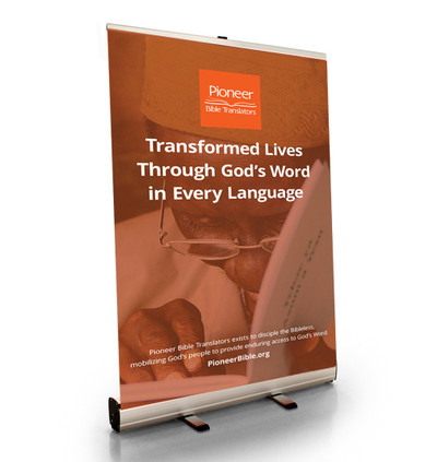 """Transformed Lives Through God's Word in Every Language Tabletop Retractor (24""""W x 41""""T)"""