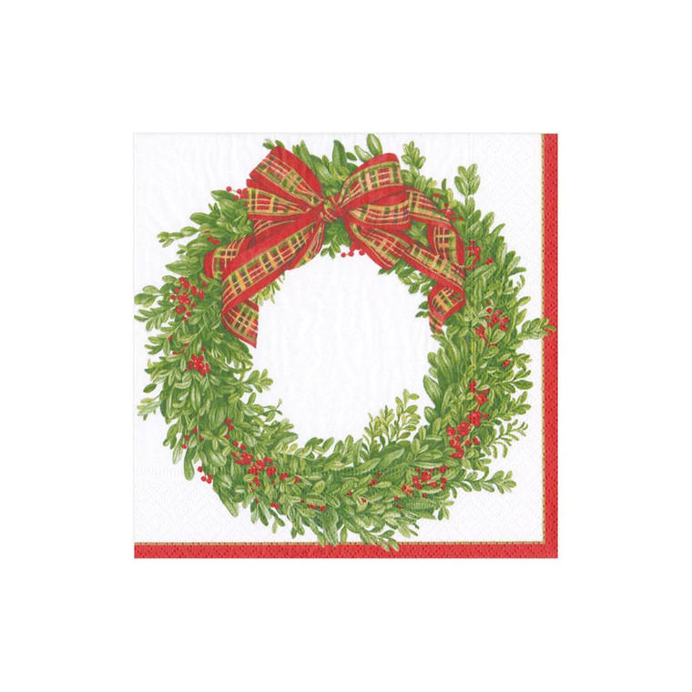 Simple, elegant and traditional, this boxwood wreath adorned with red berries and bow is an instant classic!