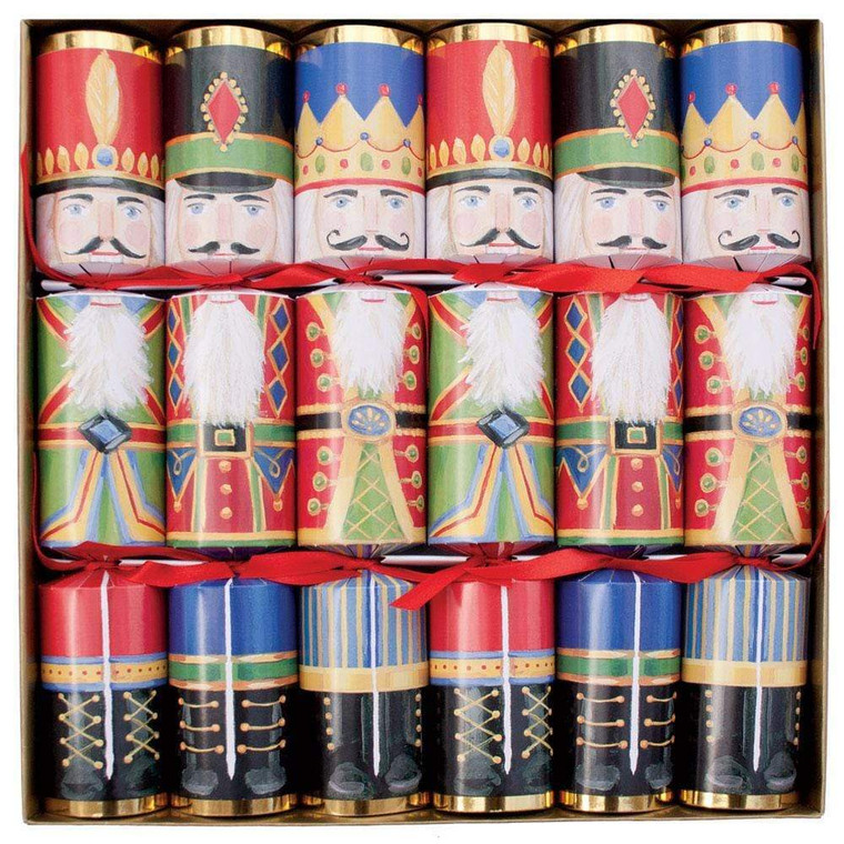 """Our Christmas Crackers each feature classic Caspari paper designs and additional luxury embellishments, such as 3D die-cut appliqués, special ribbon, and more unique details. Each Christmas Cracker contains a foil paper crown, a joke, and one trinket. 6 Christmas Crackers per Box 12""""L Crackers"""