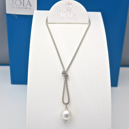 White Dangle Pearl Pendant With a Knot