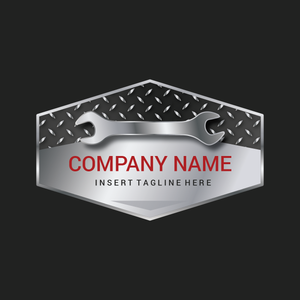 A spanner on a hexagon metal plate on a grey color background