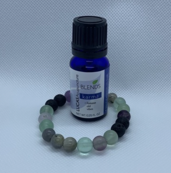 I am SO happy to work with a local artisan, Paige Berry, who has created these unique, energetically powered essential oil bracelets to go along with my essential oil blends. This bracelet that works with my Karma blend has fluorite and labradorite beads along with the lava stone (the beads that you put the drops of essential oil blend on.)  Labradoritehelps to temper the negativity within ourselves. Itis known as a stone of transformation, enhancing strength of will and inner worth. And, it issaid to stimulate the throat chakra.  Beautiful fluorite absorbs and neutralises negative energy and stress. Itincreases our powers of concentration, self-confidence, and helps us in decision-making. It encourages positivity, balances the energies, and improves balance and coordination, both physically and mentally.  You'll notice that the healing beads are in sets of three. The number 3 is thought to be the number of harmony and optimism. It can also represent body, soul, and spirit in Chinese medicine.  You may also find essential oils and blends, body care, skin care, audio recordings, self hypnosis recordings, and guided meditations on the site.
