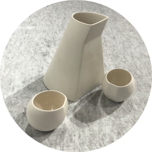 Carly Lay– EDA–PBCS 1 Snow. White Australian porcelain. EDA porcelain Bottle and cup set in snow.
