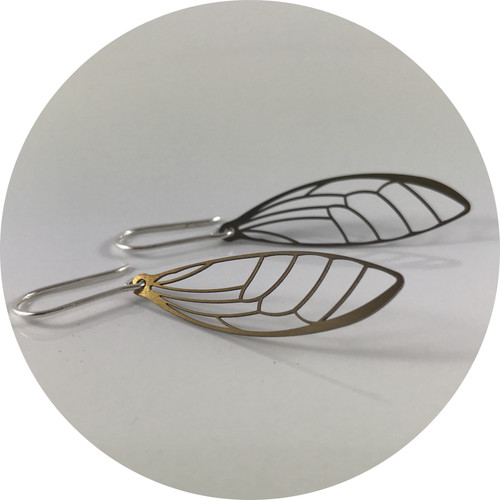Luke Abbot- Wing earrings. titanium heat treated with sterling silver hooks;
