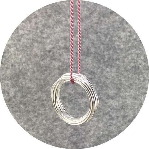 Melissa Gillespie - 'Continuous Circle Pendant on Pink Cord', sterling silver, silk cord
