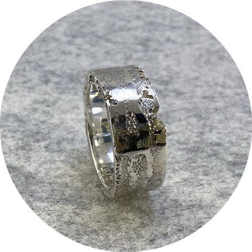 Kirra-Lea Caynes- Sterling silver and rough diamond band.  size  P