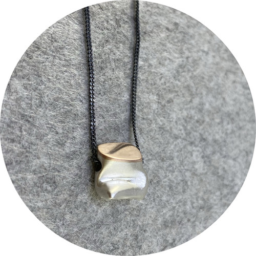 Robyn Clarke- Crushed pendant with rose gold detailing. Fine silver and 9ct rose gold pendant with oxidised sterling silver chain.