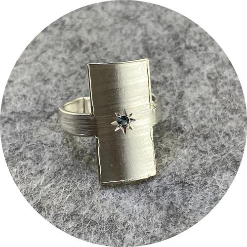 Nina Baker- Rectangular signet ring with sapphire. sterling silver . size K.