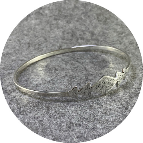 Kimba Pham- As Above so Below Bangle. Sterling silver.