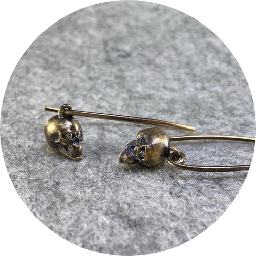 Brendan Cunningham- 9ct yellow gold skull drop earrings with diamond eyes.
