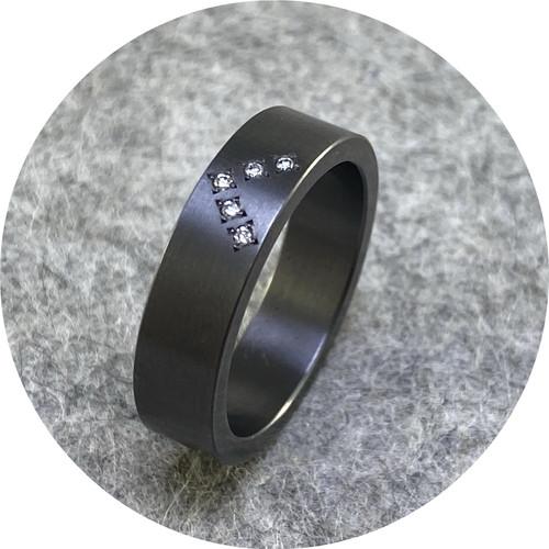 Phoebe Porter- Chevron diamond ring. Tantalum, white diamonds. size N