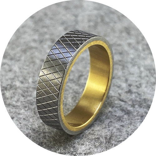 Phoebe Porter- Diamond cut sleeved ring. Stainless steel and 18ct yellow gold inner. size M.