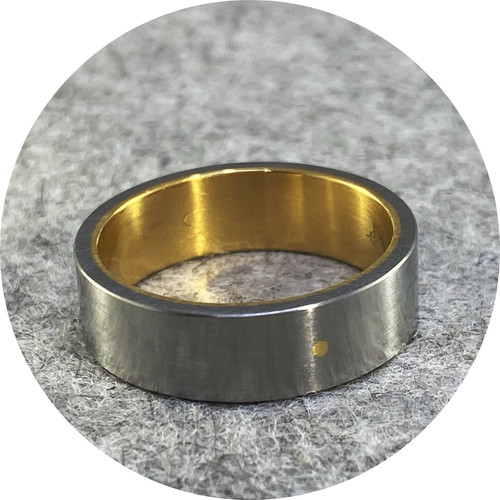 Phoebe Porter- Sleeved ring. Stainless steel and 18ct yellow gold . size T