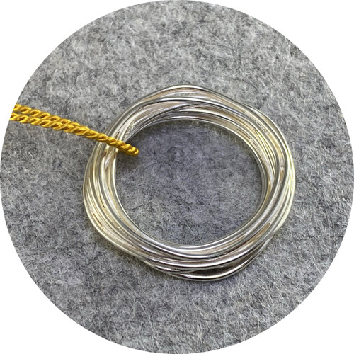 Melissa Gillespie - 'Continuous Circle Pendant on Mustard Cord', 925 silver, silk