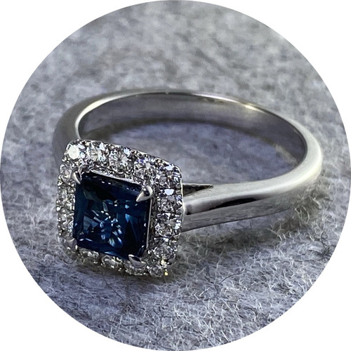 KIN- 18ct white gold ring. 1.04ct square Inverell sapphire.  0.25ct G/H SI diamonds rbc.  size  N