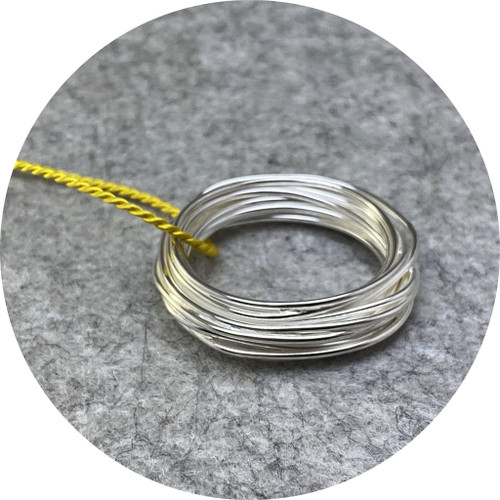 Melissa Gillespie - Continuous Circle pendant on yellow cord, 925 sterling silver, silk cord