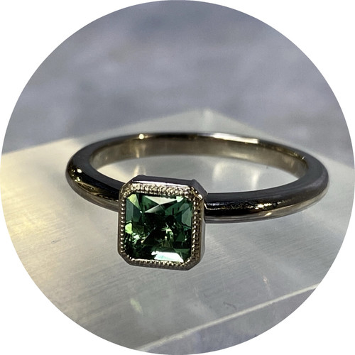 KIN- Blue/Green tourmaline solitaire in 18ct white gold. size O.5