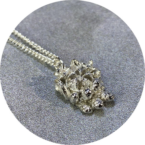 Manuela Igreja- Tiny Tussie Mussie M necklace in sterling silver.