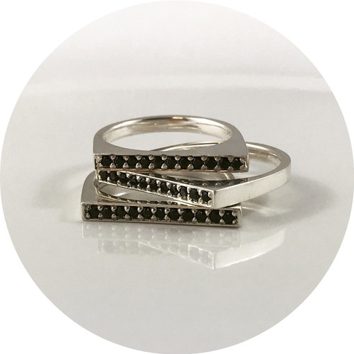 "Orion Joel- silver stacker rings. ""Wayward"" set with 11x 1.5mm black spinel"