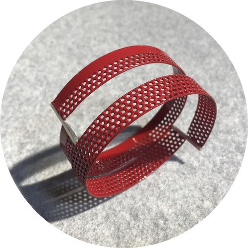 Jin Ah Jo- Perforation bangle, red powder coated mild steel and sterling silver.