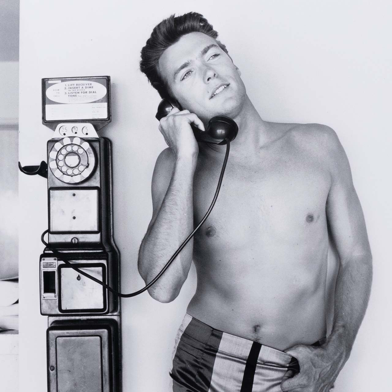 Clint Eastwood Takes A Call By Getty Images