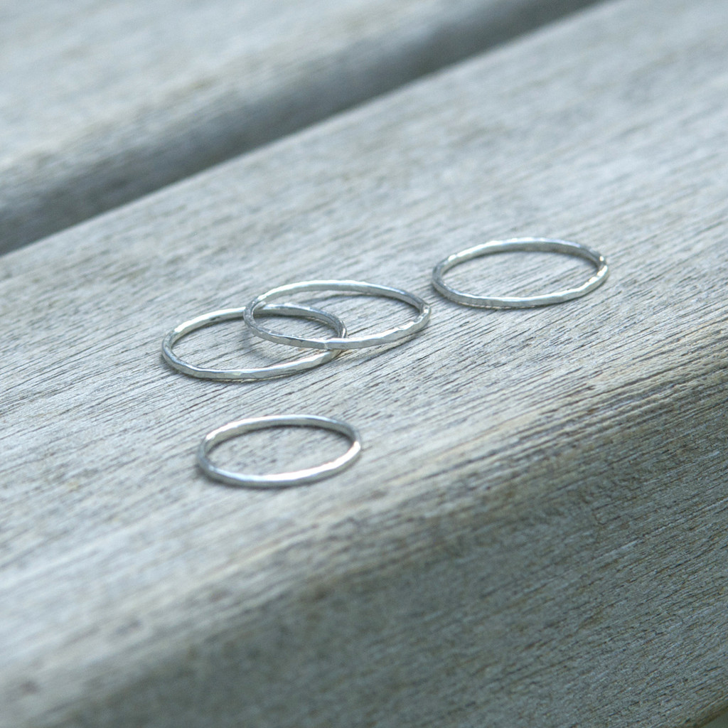 four sterling silver stacking rings