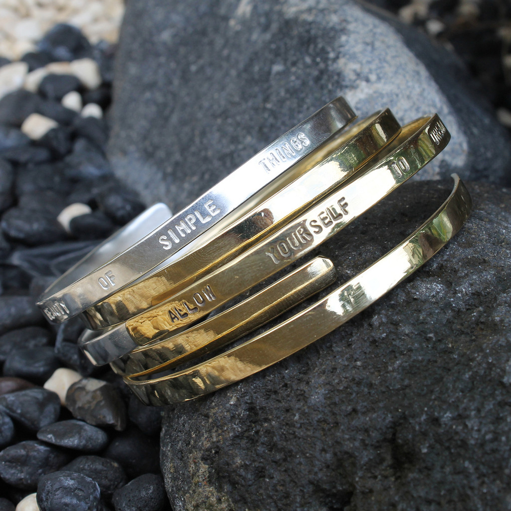 Polished silver wrap bangle with DELIGHT IN THE BEAUTY OF SIMPLE THINGS and brass ALLOW YOURSELF TO DREAM