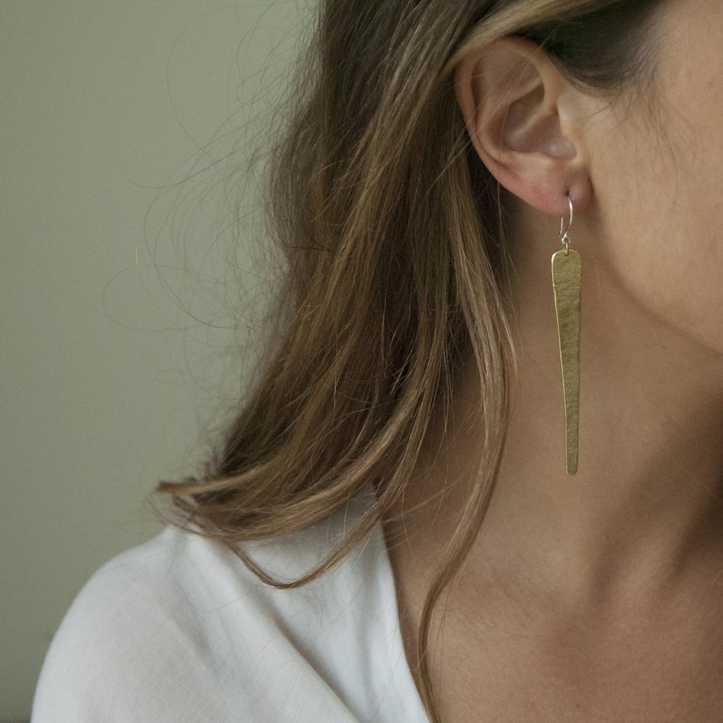 Long, textured drop earrings in brass