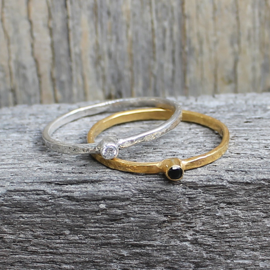 Sterling silver and 14 carat gold plated sterling silver rings with solitaire black and white stones