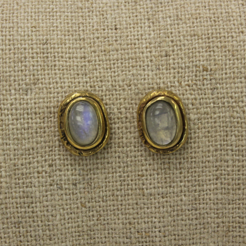 brass earrings with moonstone detailing