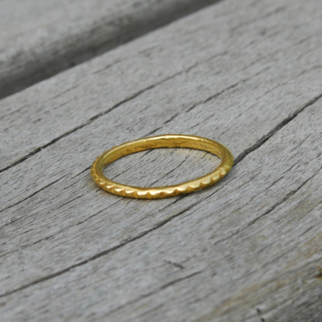 delicate simple 14 carat gold plated sterling silver stacking ring with a bit of edge