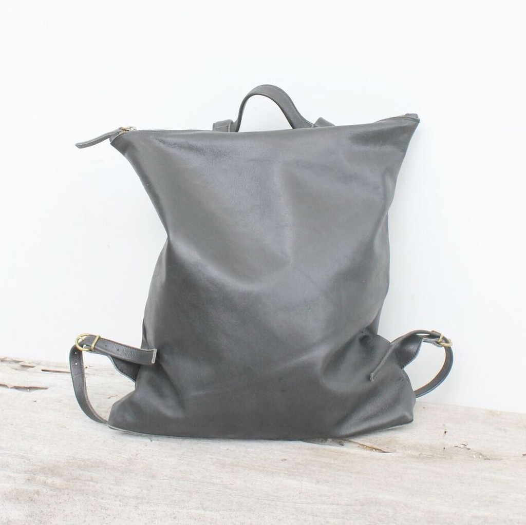 minimalist design grey leather backpack with top zipper and adjustable straps