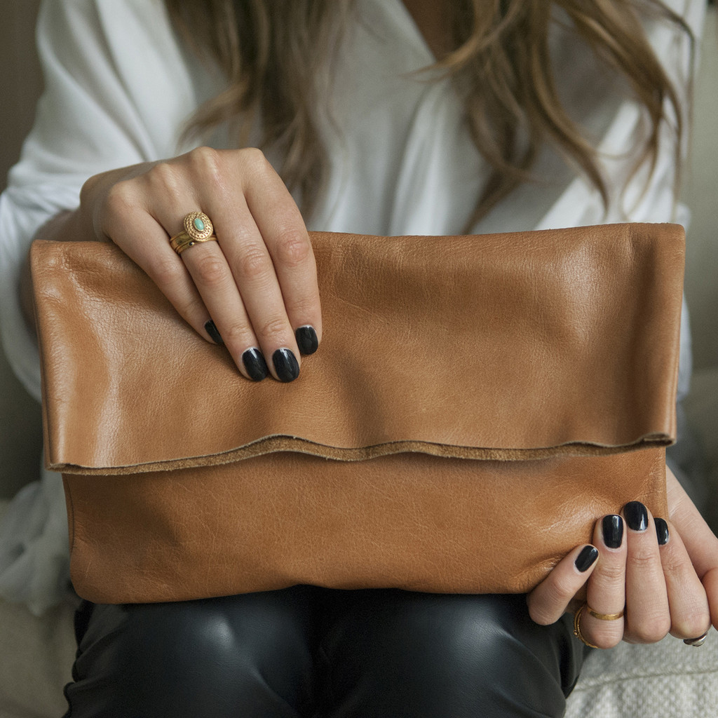 caramel coloured brown fold over clutch with zipper