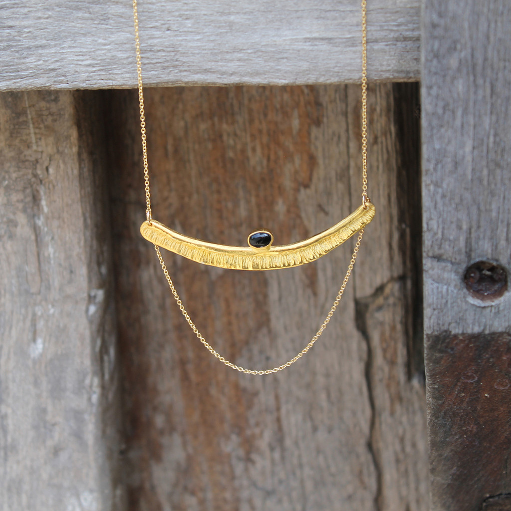 Textured bar with black onyx stone detailing and multi-length gold-filled chain