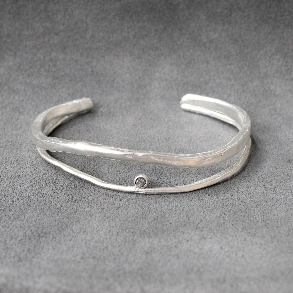 adjustable silver cuff with raw diamond detailing