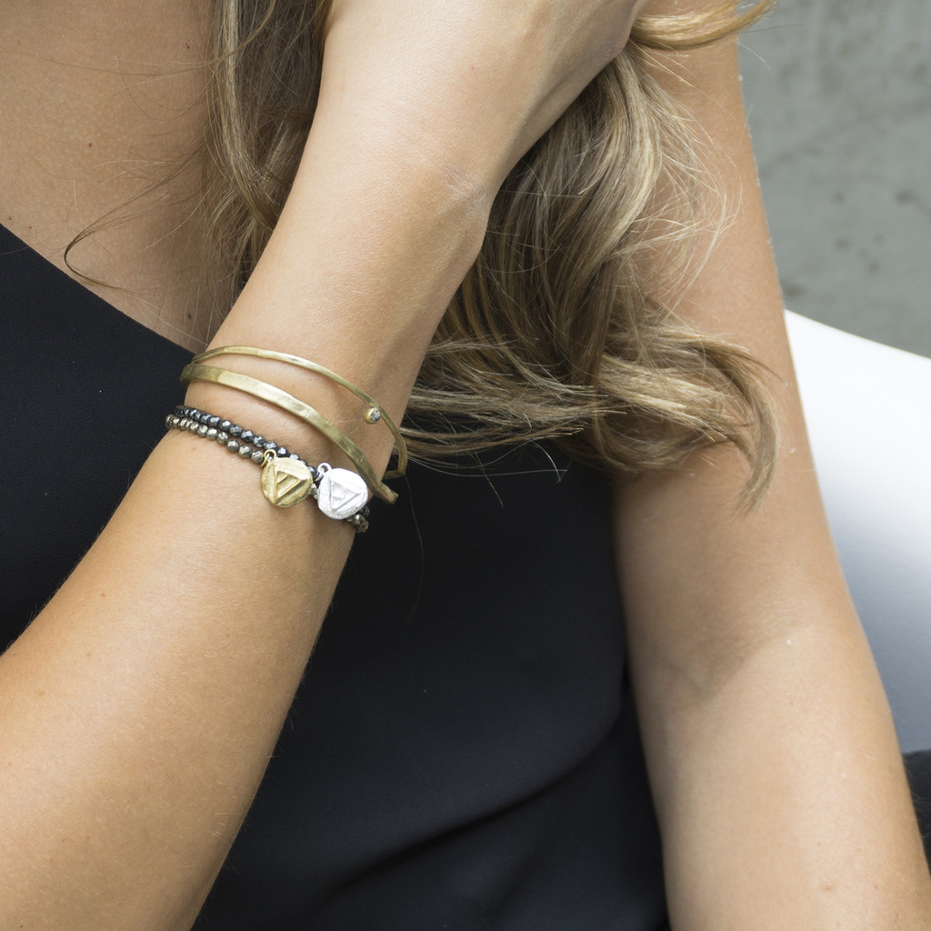 silver and brass 'explore' glyph bracelets with genuine hematite stones