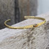 Brass thin cuff with tiger's eye inset stone
