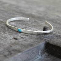 Silver thin cuff with turquoise inset stone