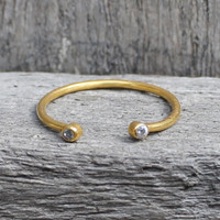 gold plated open ring with white stone