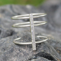 Silver statement ring with hammered detailing