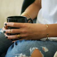 14 carat gold plated stacking rings with solitaire white, black and smokey quartz stones