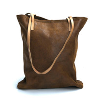 cognac leather tote bag with simple tab closure