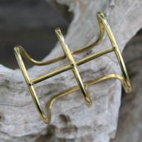 adjustable brass statement bracelet with black stones